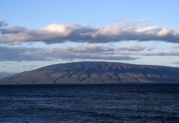 Across the Au'au Channel from West Maui region - to the stratus cloud casting a shadow across the eroded volcanic gulches, of the northeast flank, of the island of Lana'i