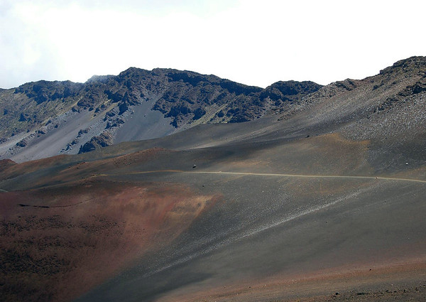 Cloud shadow across the Haleakala Crater, along the Sliding Sands (Keonehe'ehe'e) Trail - with the sunlit southern rim of the crater above - Haleakala National Park - Upcountry region