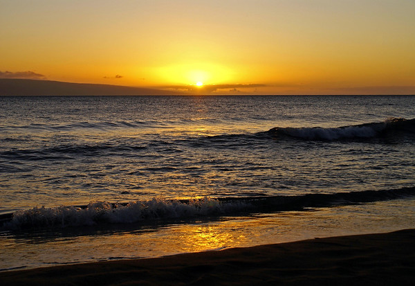 Sunset at the northern end of the island of Lana'i - from the waves breaking on West Maui region