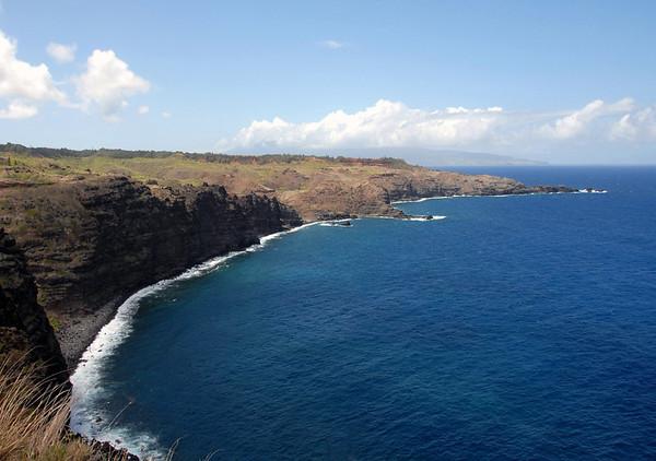Across Poelua Bay - to Nakalele Point, the northernmost end of both the Mauna Kahalawai (West Maui Mountain) Volcano and the island Maui - with the northeastern end of the island of Moloka'i in the distance