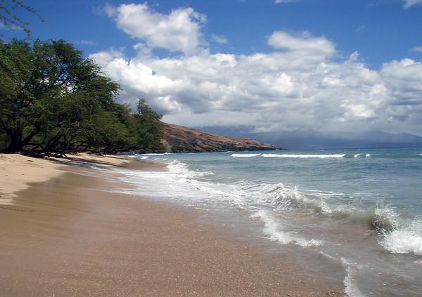 Ukumehame Beach - viewing eastward across the southern end of Mauna Kahalawai Volcano - West Maui region - to Mauna Haleakala in the cumulus clouds