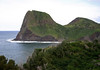 The vegetated extrusive igneous rock of Kahakuloa Head, rising 636 ft. (144 m) above Kahakuloa Bay - with Pu'u Kahuli'anapa (hill) beyond - Central Maui region