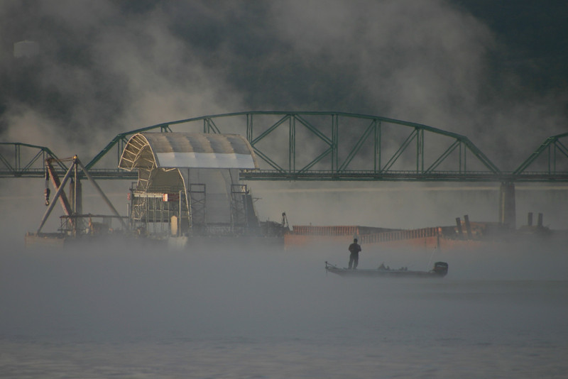 Early morning fisherman in the fog on the Tennessee River