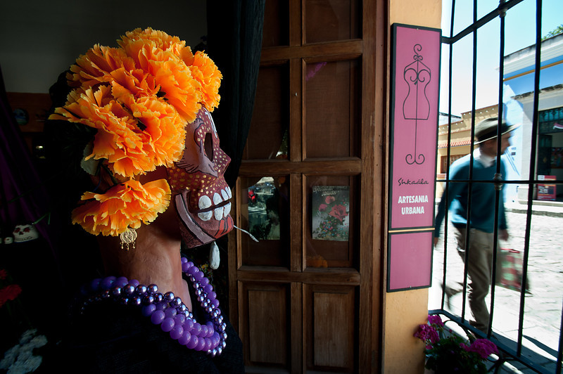 Day of the dead mask keeping track of Oaxaca pedestrian traffic.
