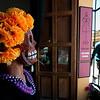 Day of the dead mask keeping track of Oaxaca pedestrian traffic.