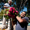 Hermenejildo Cruz and his son delivery flowers to their stall outside the cemetery.