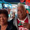 Buying souvenirs from Lorenzo Juan, a merchant in Oaxaca's main market, Mercado Abastos. He pulled his wife into the picture.