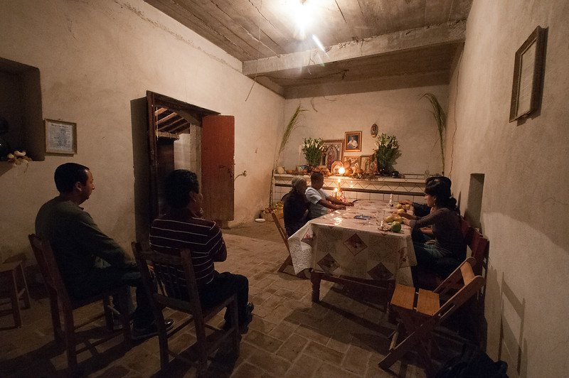 Instead of congretating at the town cemetery during the night, villagers go from house to house to drink, eat and visit with family and friends.