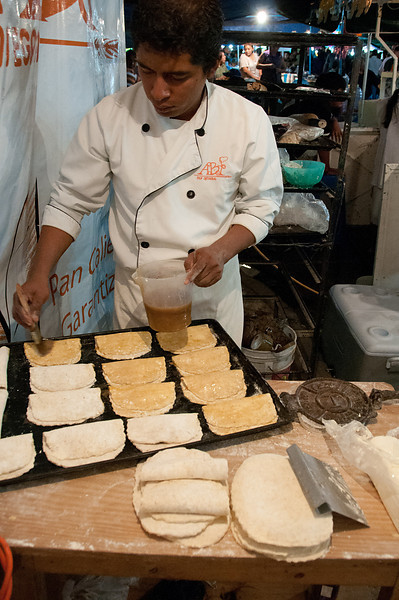 Chocolate pastries being prepared and baked at a food stall outside the Panteón.