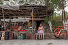 A woman sells Mayan relared woodcarvings by the side of the road. (Pisté, Yucatán, MX - 01/14/16, 2:36:09 PM)