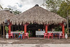 Women wait for customers at an outdoor refreshment stand. (Pisté, Yucatán, MX - 01/14/16, 2:37:10 PM)