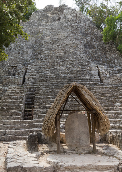 La Iglesia pyramid and stela under thatched roof in Coba, Yucatan Peninsula, Mexico