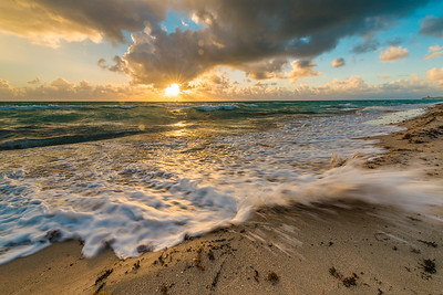 An incredible sunrise over the waves of Miami Beach Florida