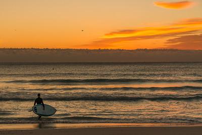 Mimi Sunrise surfer