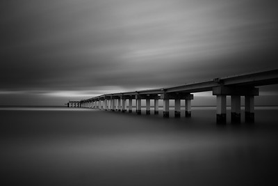 Long exposure of Sunny Isles Pier on a windy beautiful cloudy day