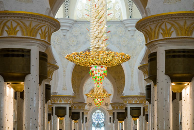 Massive chandeliers line the interior of the Grand Mosque
