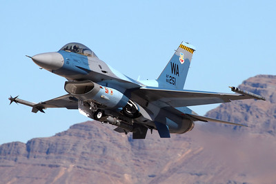 "Reg: 86-0251		   Code: WA Operator: USA - United States Air Force Type:  General Dynamics F-16C Fighting Falcon		   C/n: 5C-357   ""Aggressor 51"" climbing out of Nellis Air force base, leading the Red Team into action at Red Flag 02-08. The Weapons Academy aggressor aircraft wear a variety of camo schemes to represent foreign air arms in the training missions.     Photo Date: 24 January 2008 Photo ID: 1200422"