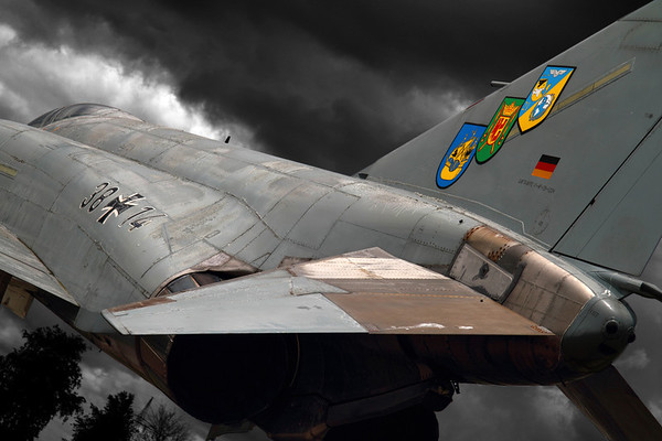 Reg: 38+14 Operator: Germany - Luftwaffe Type:  McDonnell Douglas F-4F Phantom II C/n: 4646   Captured against a moody sky, this JG71 Richtofen Phantom was retired in Autumn 2006 and is preserved at a cross-roads in the town of Wittmund in Northern Germany, near to its former base of Wittmundhafen AFB.     Photo Date: 05 June 2012 Photo ID: 1200412