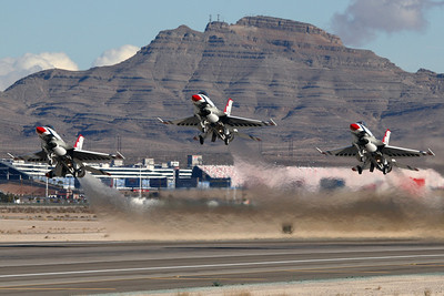"Reg:  Operator: USA - United States Air Force Type:  General Dynamics F-16C Fighting Falcon		   C/n:    Three ""Thunderbirds"" power into the Nevada skies on a formation take-off from their home at Nellis Air Force base.     Photo Date: 24 January 2008 Photo ID: 1200420"