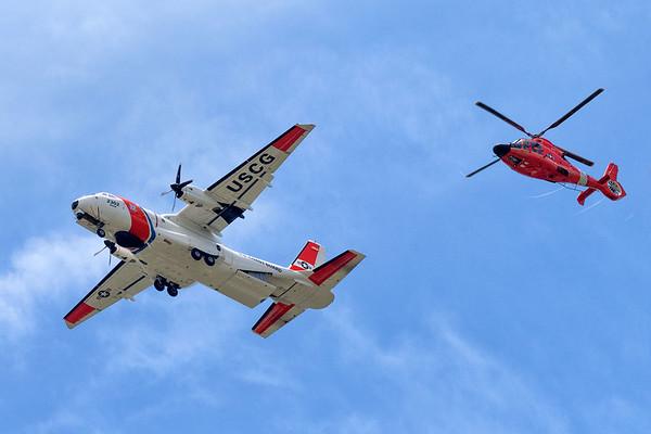 U.S. Coast Guard MH65 helicopter and a U.S. Coast Guard C-144 aircraft