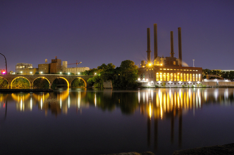 The Stone Arch Bridge with the Southeast Steam plant on the Mississippi River.