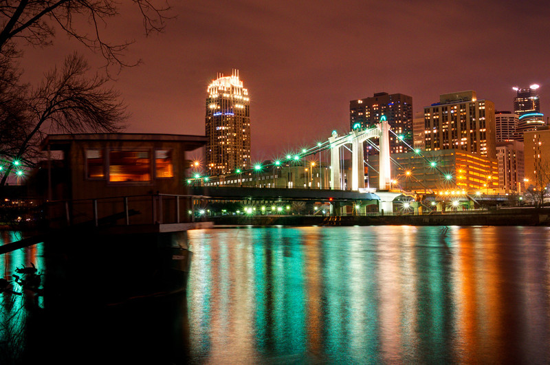 A view of the Hennepin Avenue Bridge reflecting in the Mississippi River.