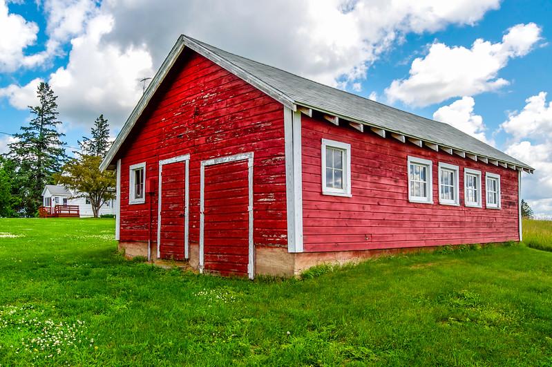 Red Outbuilding & White Farmhouse
