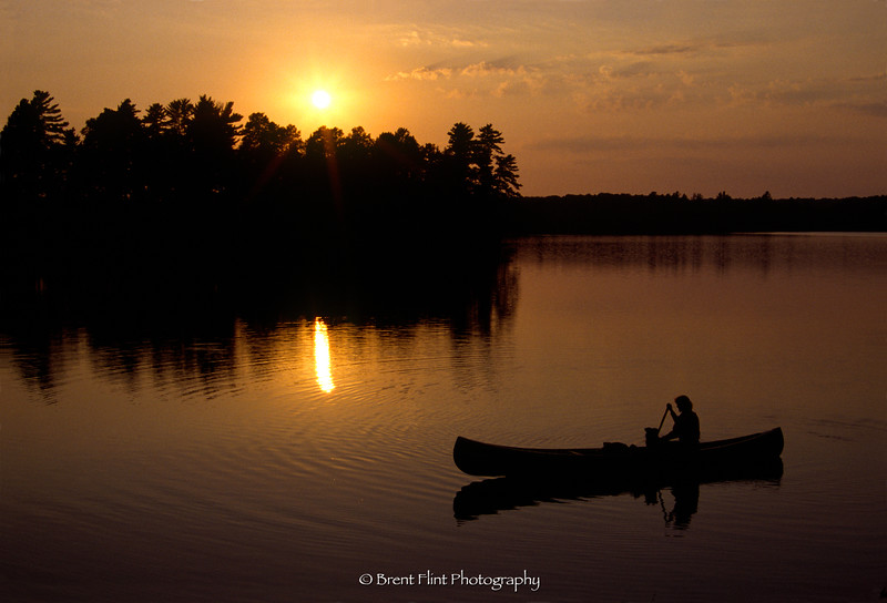 S.3349 - canoeist at sunset, Itasca County, MN.