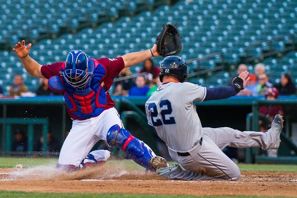 Corpus Christi Hooks outfielder Derek Fisher slides across home plate as catcher Chris Gimenez looks for the ball at home plate. (Photo by Sam Hodde)