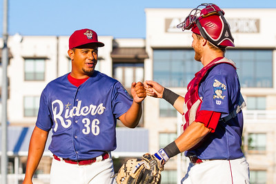 Frisco RoughRiders' Juan Grullon (L) fist bumps Kellin Deglan (R) after a double play in the fourth inning of of a game against the Springfield Cardinals at Dr. Pepper Ballpark in Frisco, Texas, Sunday, June 5, 2016. (Photo by Sam Hodde)