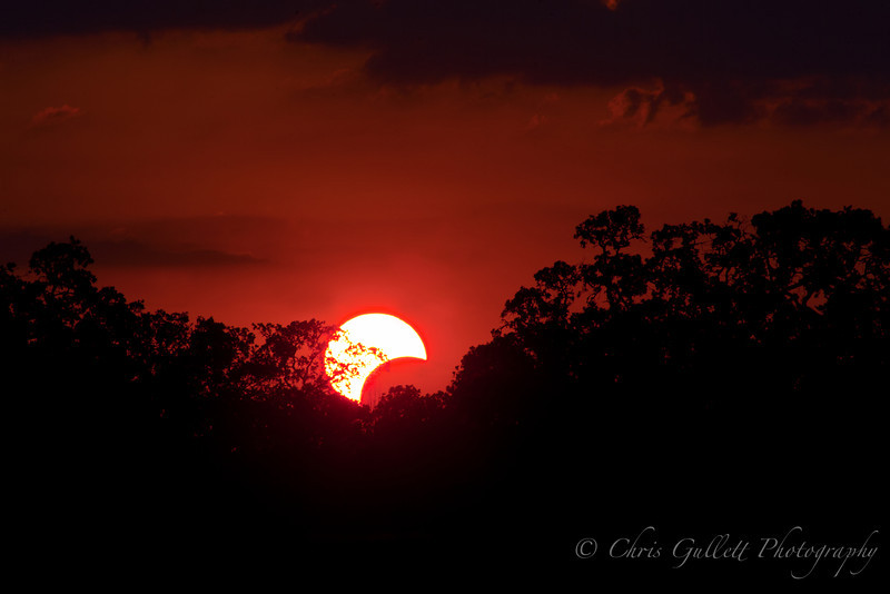Solar Eclipse At Sunset