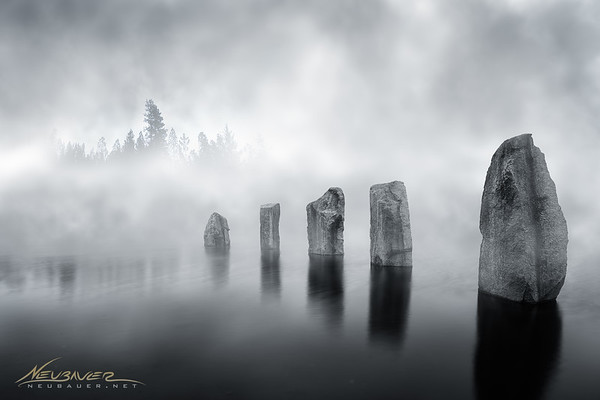 There was a fog on this little lake on the morning I took this shot that made it look so mysterious I knew I had to photograph it. The clouds hung low and it took quite a few frames before I could capture the scene in its splendor.