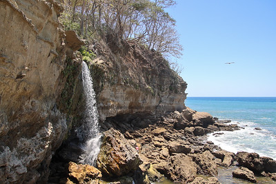 Waterfall into the ocean in Montezuma Nicoya Peninsula Costa Rica