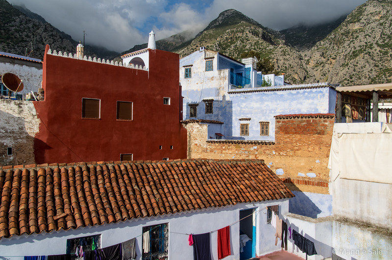 View up the hillside from our Chefchaouen hotel rooftop balcony on a brief sunny break in the late afternoon. On the first evening it was so cloudy we didn't know there were such high hills so close to the town!
