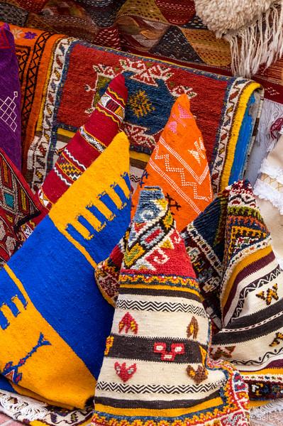 Rolled rugs in Essaouira souk.