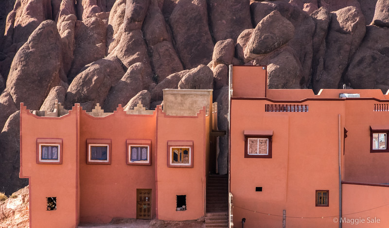 Village houses and rock formation in the Dades Valley.