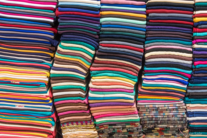 Piles of scarves in Fez souk.