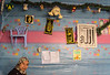 """A teacher in a one roomed school in the Medina in Fez - she invited us in and the children sang """"Twinkle Twinkle Little Star"""". Interesting collection of artifacts on the wall!"""