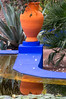 "Majorelle Gardens in Marrakech. Gardens are famous for ""Majorelle Blue"" paint and flower pots in orange, blue and yellow."