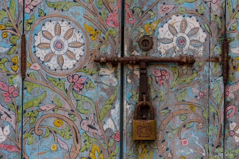 Painted doorway in the gardens of old town of Rabat.