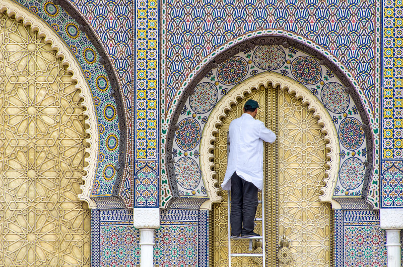 Brass doors of the Kings Palace getting their spring cleaning in Fez.