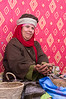 Berber woman holding Argan nuts prior to cracking them open to make Argan oil.