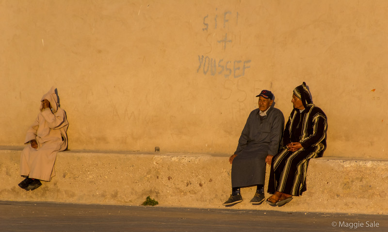Gathering along the wall to watch the sunset in Essaouira.