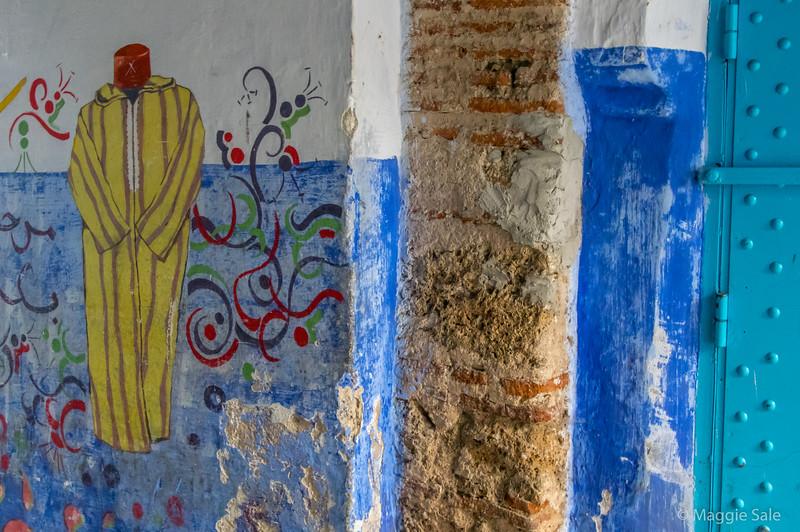 Berber wall art in a passageway.