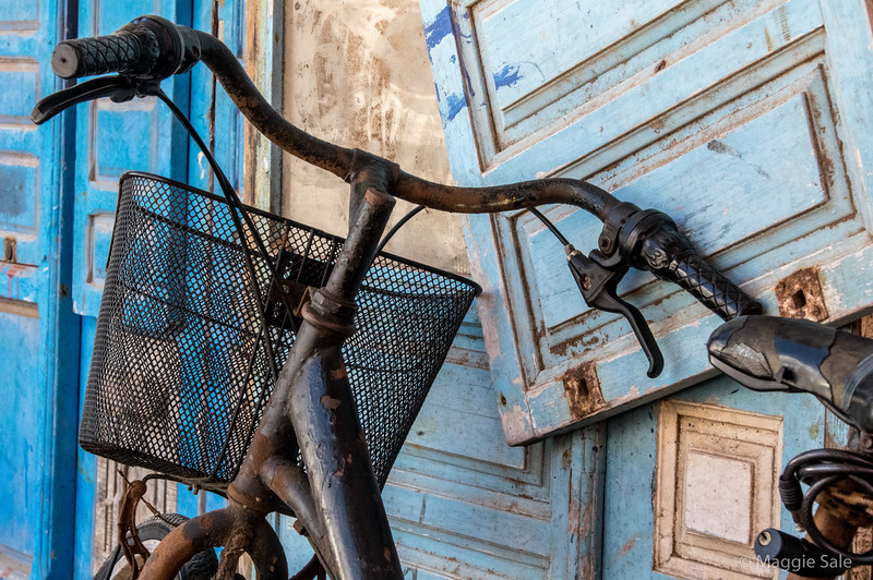 Rusty bicycle on balcony.