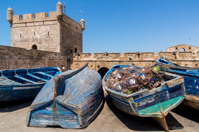 Fortifications and fishing boats at the harbour in Essaouira.