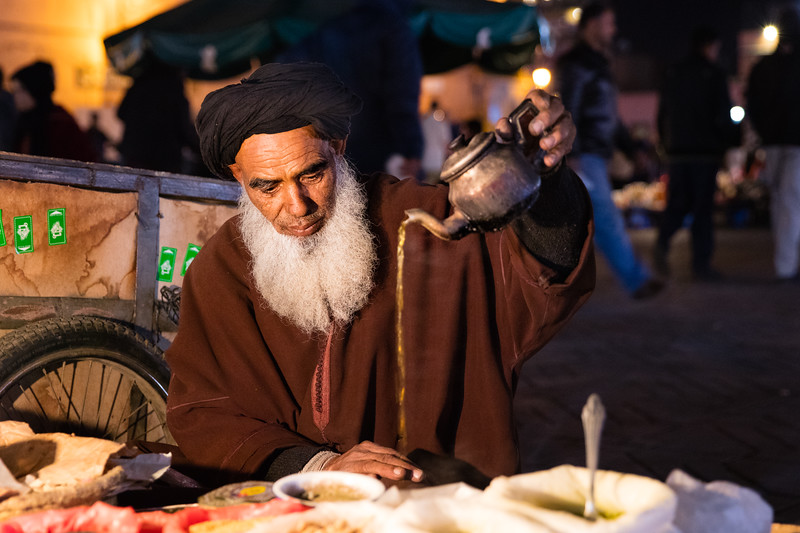 This merchant in the night market pauses for a break with the traditional Moroccan mint tea.