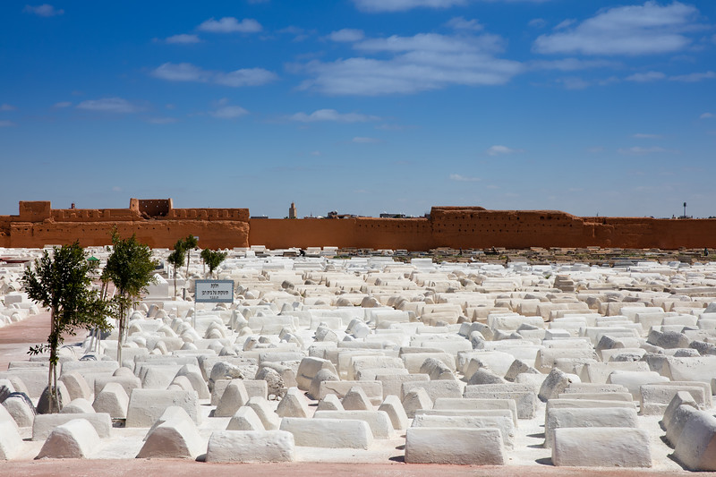 A Jewish cemetery in Marrakech Morocco with a mosque in the background.  Unlike many places in North Africa, there is little or no tension between the Arabic and Jewish population; when I asked about it, the locals don't even seem to get the question.  Custom requires that you wash your hands after leaving the cemetery to prevent angry spirits from following you out.