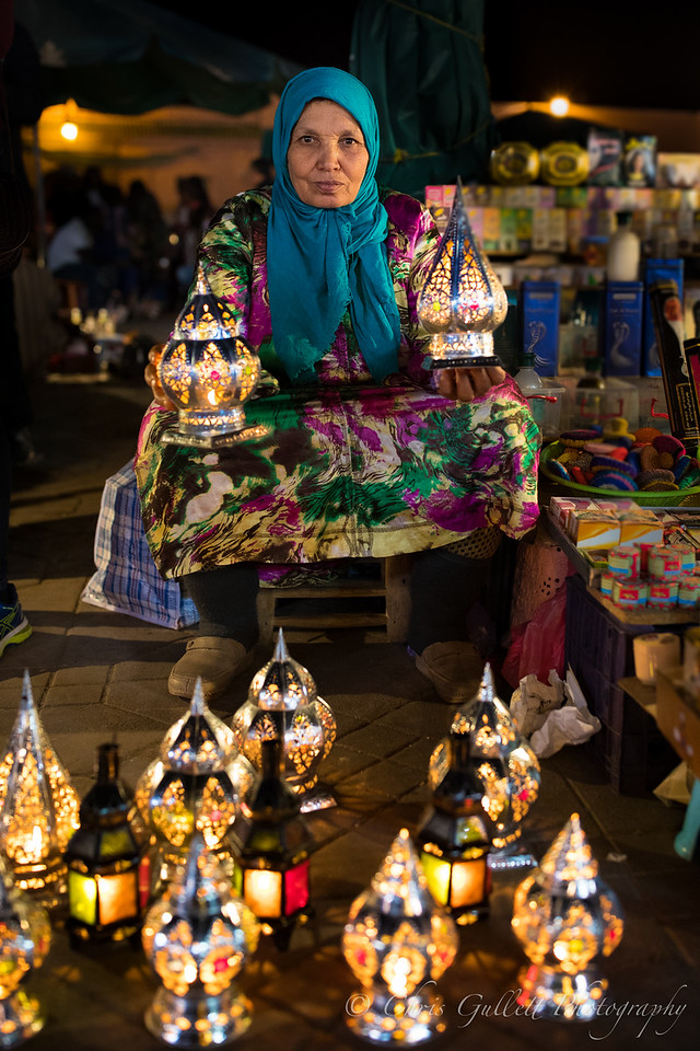 I found these Moroccan lanterns hauntingly beautiful at night in the otherworldly marketplaces.  This lady shows great character as she displays her wares.  That glare makes me wonder if I have been cursed every time I look at the photo.
