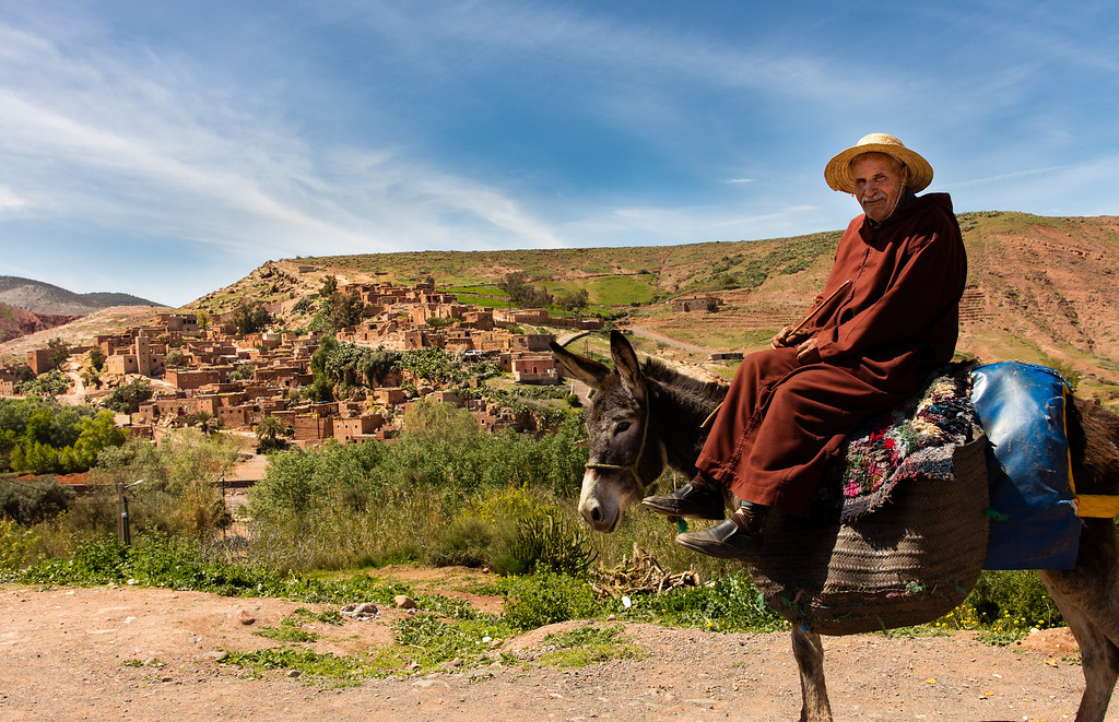 A man headed to the village you see in the background in the high Atlas Mountains.